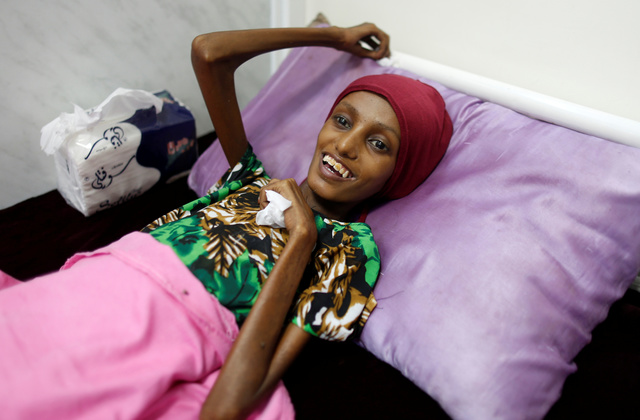 Emaciated woman finally able to smile after intense care